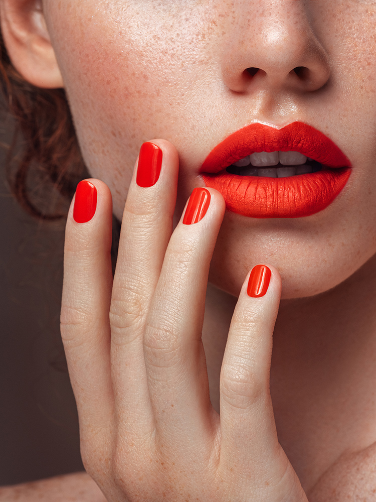 Klerely360-Womans-red-lips-and-manicure-close-up-1133211595_6123x8164
